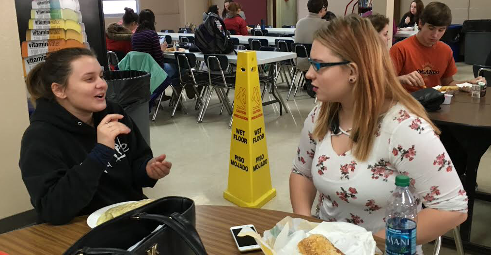 Trinity Anthony '19 (right) sits at lunch with Jess Vaillincourt '19.