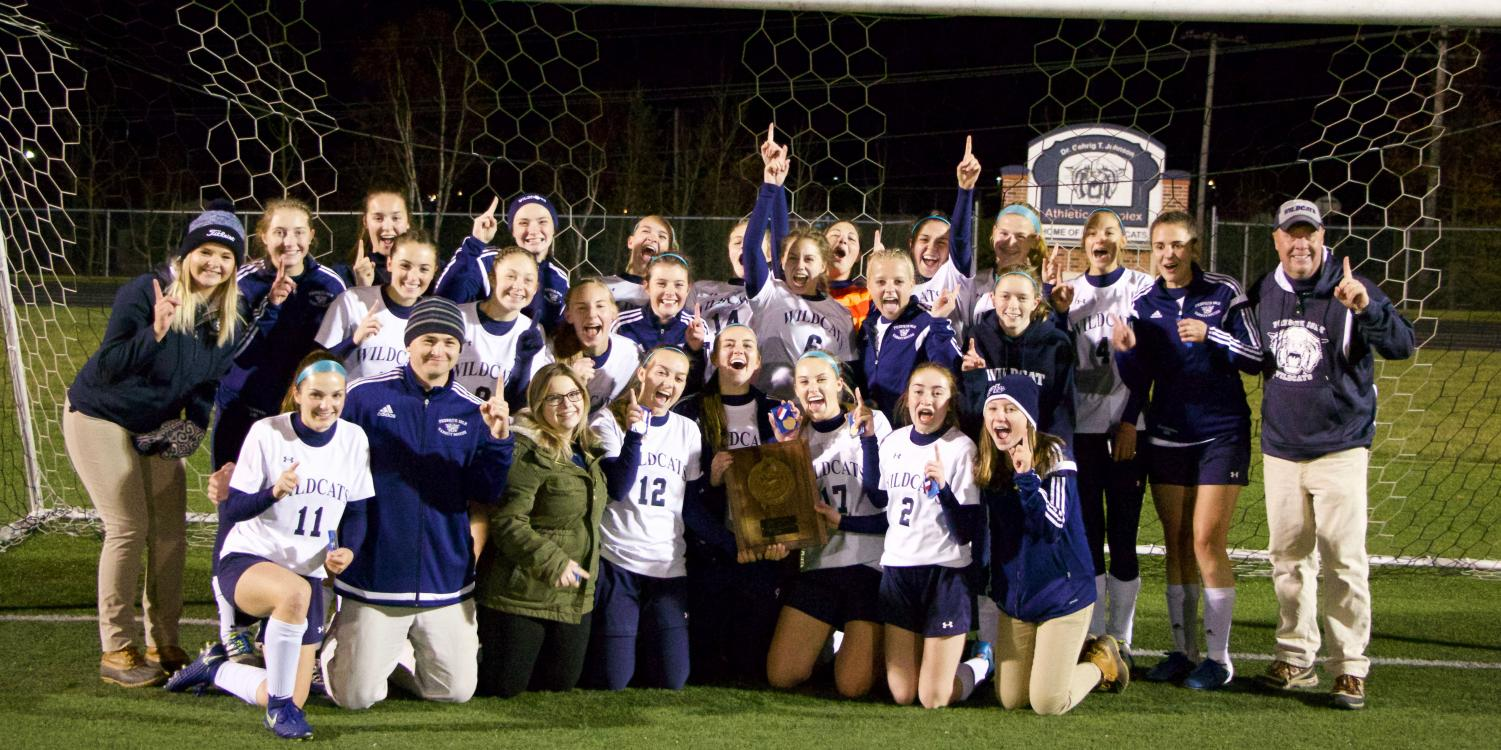 The Girls Varsity Soccer team celebrates finally claiming the Northern Maine Regional Championship trophy in a 1-0 win over longtime rival Hermon Hawks.