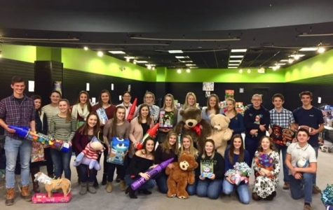 PIHS Varsity Club members organize toys at the Aroostook Centre Mall on December 12.