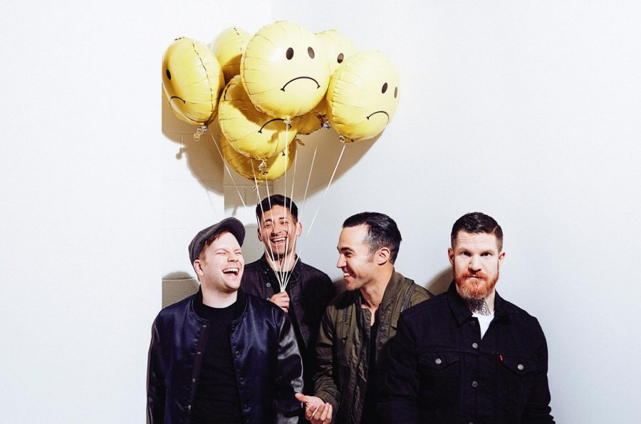 The four band members from left to right are: Patrick Stump, Joe Trohman, Pete Wentz, and Andy Hurley.