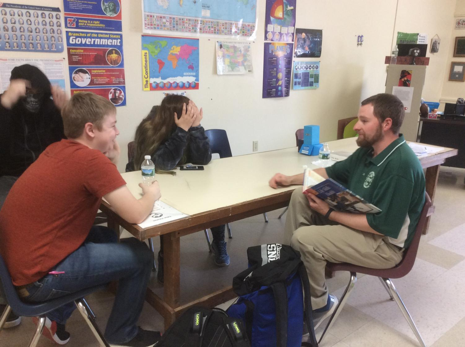 Noah Simpson sits in Mr. Carmichael's room learning about life skills on the subject of health.