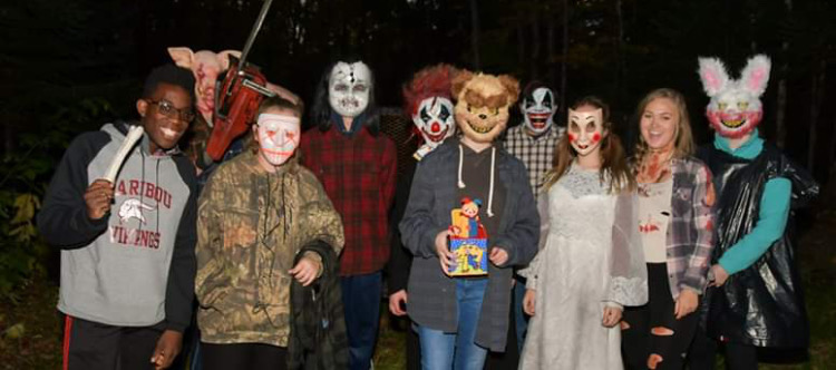 "Right: Zoe Plummer, Torrie Casey, Hailey Verret, Richard Bellamy, Aaliyah Lichterman, Landyn Newlands, Seth Roy, Marina Tucker, Cody Tucker and Iffy Sargent stand to het their picture taken before the walk. "" Be scary"" said Pete Freeman, photographer. They were all so cold it was hard to stand still."