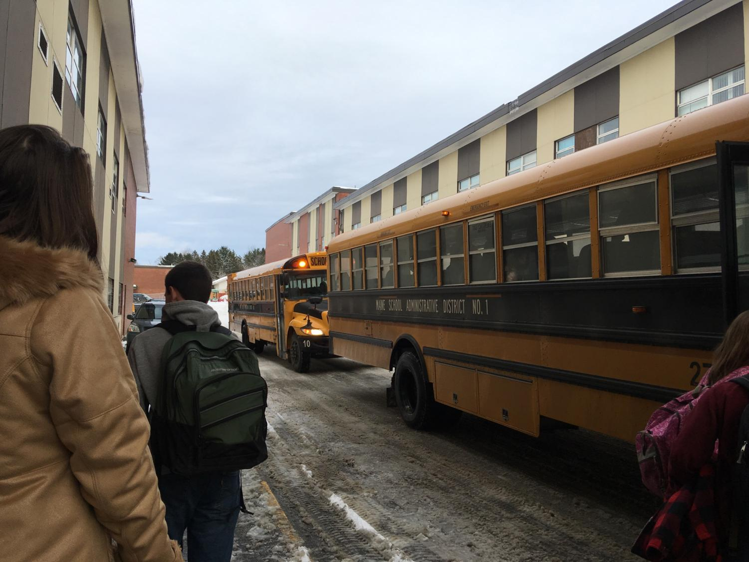 "PIHS students board the buses after school outside the cafeteria on November 29.  Bus accidents have made headlines in many other places in the country recently.  ""Unfortunately people more and more are making horrible judgement calls that jeopardize the safety of so many around them,"" said SAD 1 parent Maeghan Swanson."