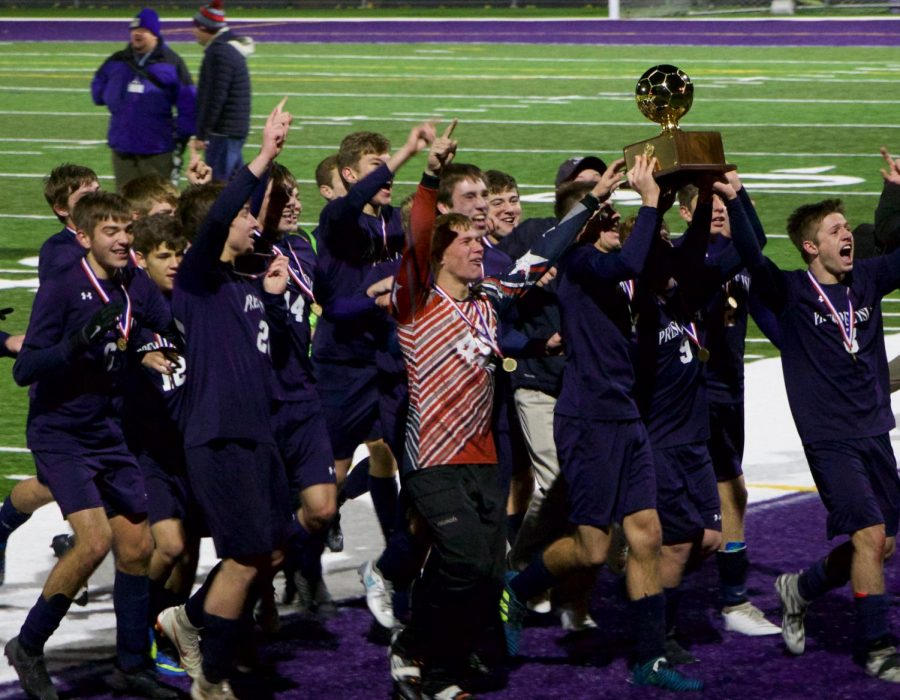 The+boys+varsity+soccer+team+celebrates+while+holding+the+gold+ball.+They+won+the+state+championship+for+the+first+time+in+PIHS+history.+%E2%80%9CYou+always+have+to+have+the+mindset+if+you+want+to+win%2C%E2%80%9D+said+Jason+Dumais+%E2%80%9819.