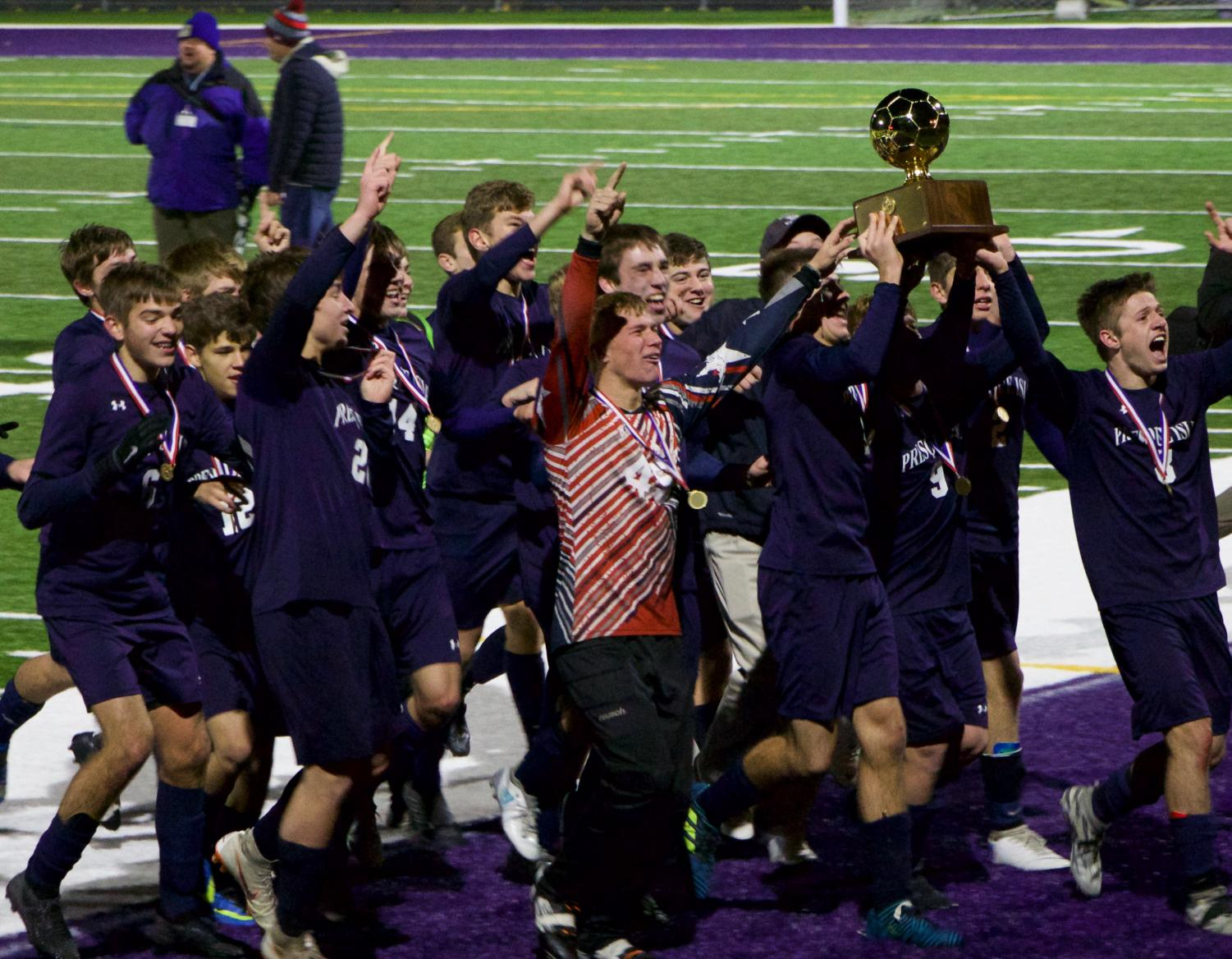 "The boys varsity soccer team celebrates while holding the gold ball. They won the state championship for the first time in PIHS history. ""You always have to have the mindset if you want to win,"" said Jason Dumais '19."