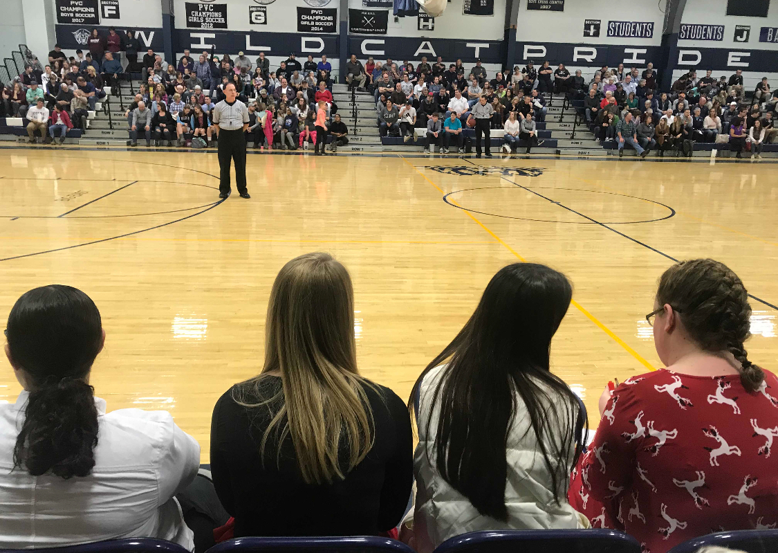 Did you mark that down on your stat sheet? Two Senior's sidelined Savannah Rodriguez and Sydney Thompson. Sitting beside them Managers Riley Davis, and Carly Guerrette pay close attention to the game as they keep stats at the Varsity Girls basketball game On December 22.