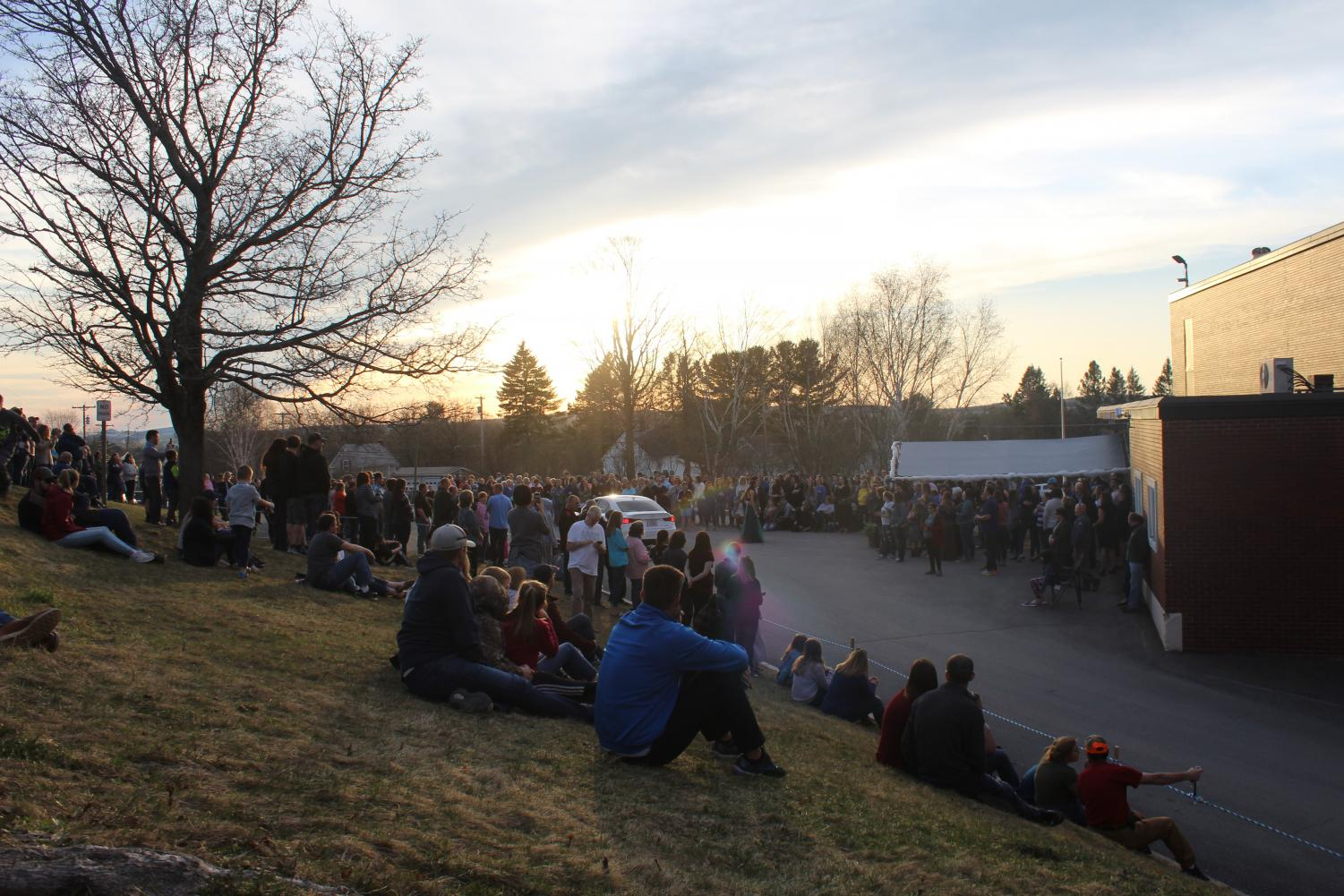 Outside the PIHS gym entrance, a crowd of almumni, parents, and Presque Isle community members turn out to watch the annual prom parade arrival on May 4.