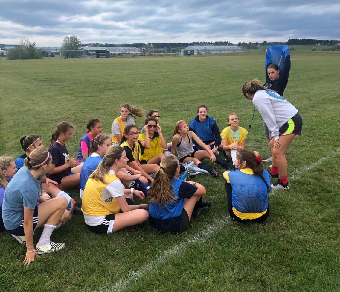 "JV soccer coach Delaney Williams stands in front of her team at practice on September 4. ""I love kids, and I love soccer. Coaching soccer here is all of that and more,"" she said."