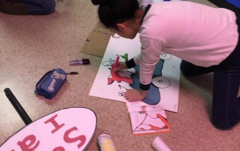Joy Wang '20 decorates for her Dr. Seuss themed hall during Deck the Halls in November 2019.