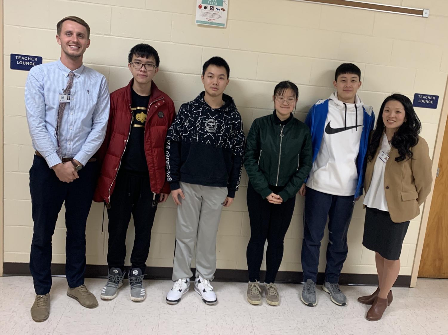 Left: David St. John, Gary Lin, Blaine Mo, Shadow Qin, Karry Gao, Melanie Junkins pose for a picture during St. John's first trip to PIHS.
