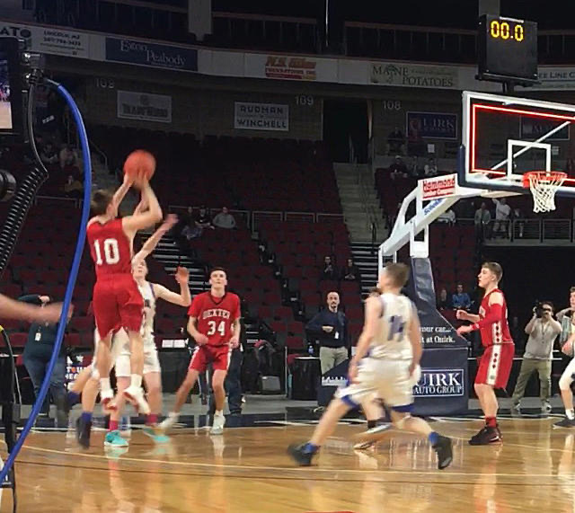 Parker Ponte shoots the game-winning shot in the Class C Boys Regional Final against Central Aroostook as the clock shows zero.