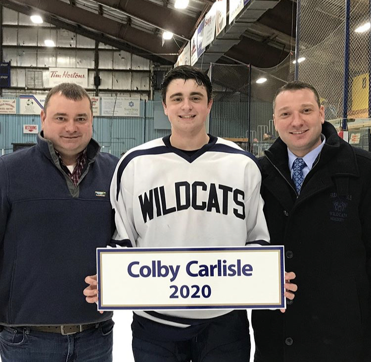 Junior+Colby+Carlisle+poses+with+his+father+and+uncle+following+his+100th+point+on+January+25th+at+the+Northern+Maine+Forum+in+Presque+Isle
