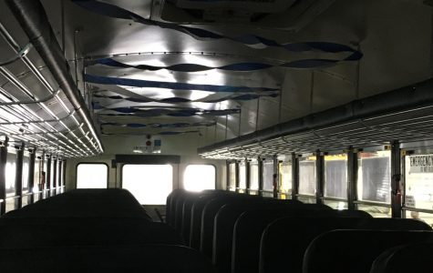 A bus decorated in Wildcat colors prepares to leave for an ice hockey playoff game.