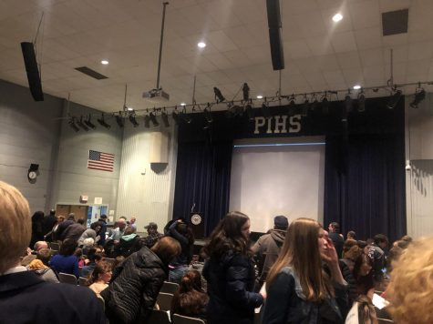 Athletes, coaches, and parents prepare to leave the auditorium following the conclusion of the Winter Sports Awards presentation on March 9, 2020.