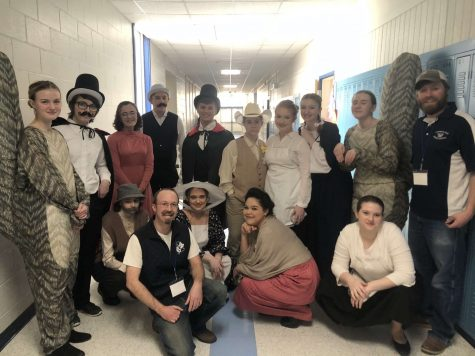 The cast poses backstage at Lawrence High School on March 7.