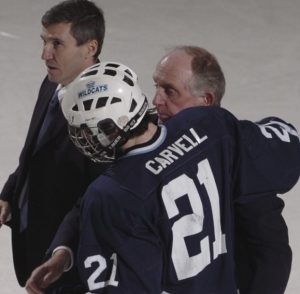 """Former assistant John Haley talks to senior Mark Carvell during a 2009 game. """"John was an ambassador for our sport and for the County,"""" said head coach Carl Flynn."""
