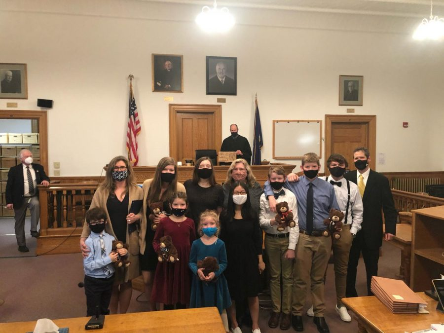 The newly expanded Morningstar family poses in the Caribou Courthouse on November 23.  It was the first official family photo after the adoption process was completed.