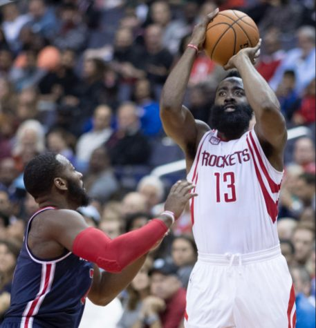 Harden shoots a difficult shot over a defender. Harden has announced he is open to trade.