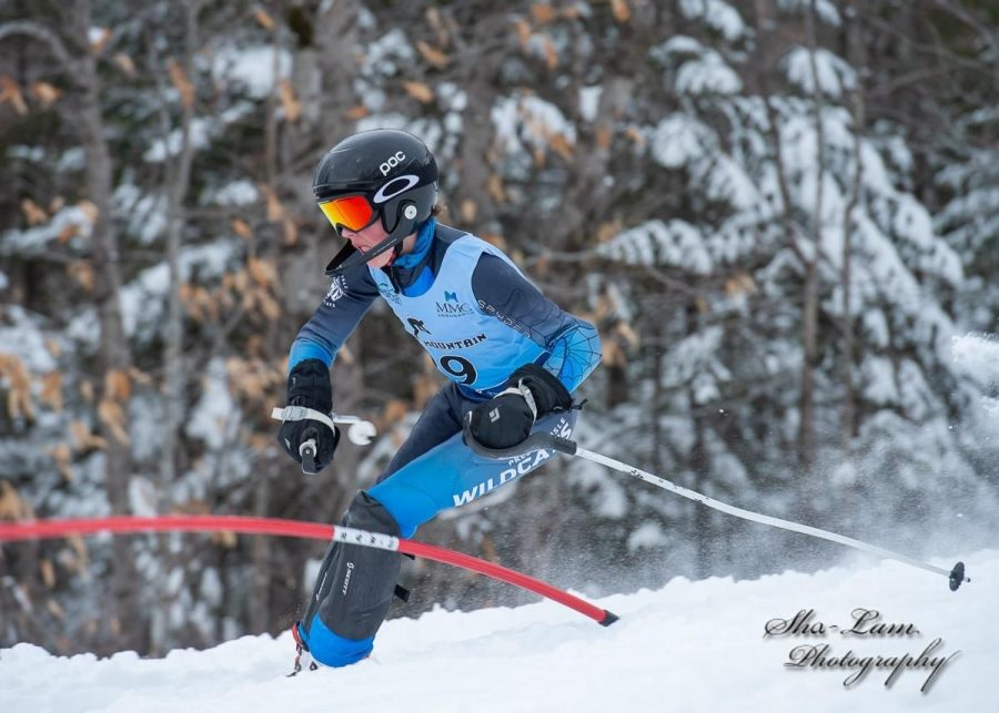 Clay Gregg '22, avoids a gate during a February 2020 race at Bigrock Ski Area in Mars Hill, Maine.