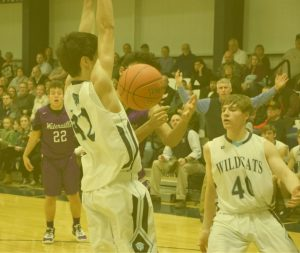 Nate Willett '20, deflects a pass during a home contest against Waterville in early 2020.