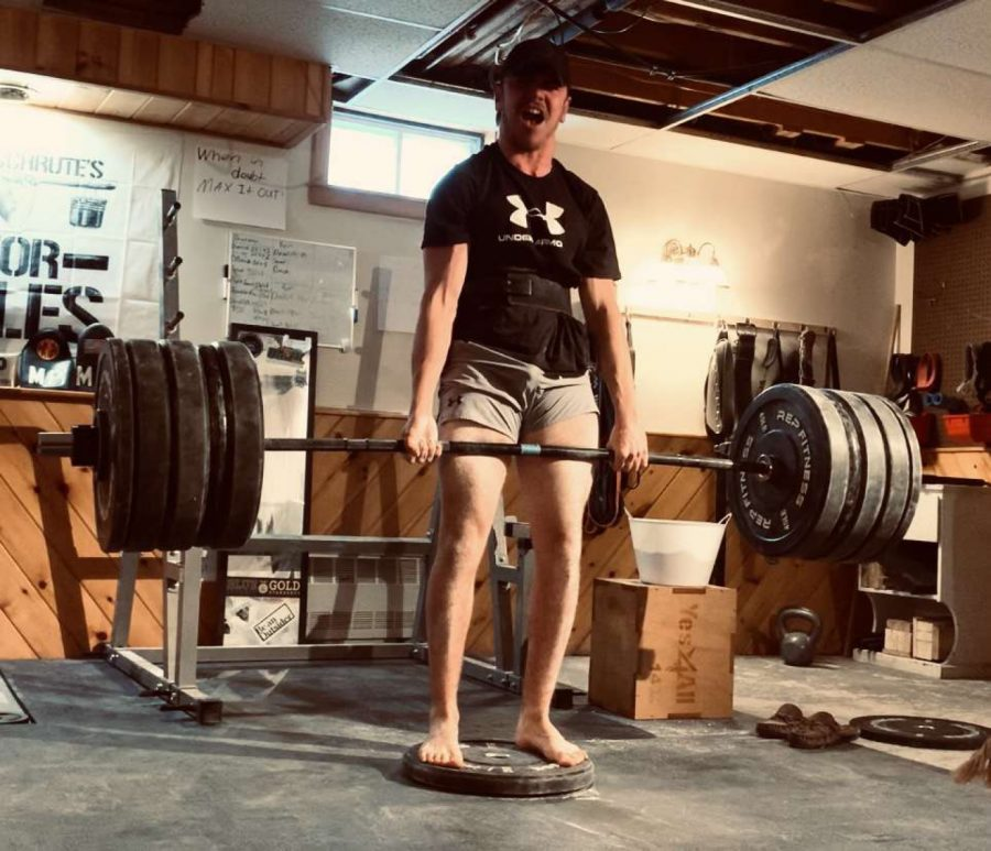 "Eighteen year old Brandon Dubie '21 deadlifts in his home gym. ""I did bodybuilding, and it was fun,"" he said. ""But to me it was too repetitive and I wasn't seeing progress with it. Then I started throwing heavier weights in and I saw progress with my strength so I started to strive for that."""