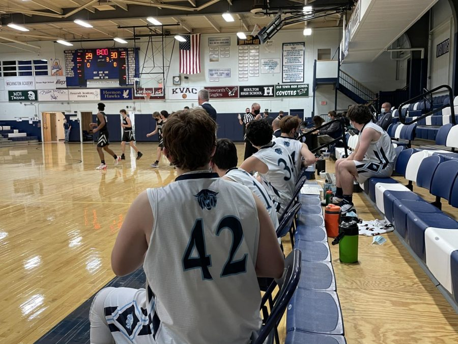 The Wildcat bench looks onto the action during the third quarter of their season opener.