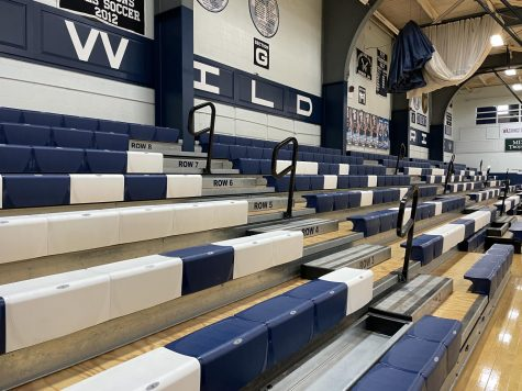 Bleachers in the lower gym at Presque Isle High School stand empty, devoid of parents and students alike due to the indoor gathering restrictions put in place by the Maine CDC.