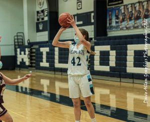 Senior Julianna Morningstar (42) takes a jump shot during a February 2021 game against Caribou