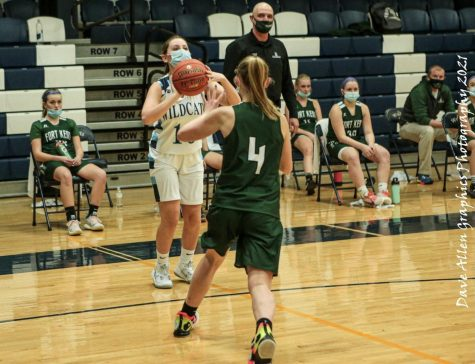 Hattie Bubar (10) attempts a three point shot during a February 2021 meeting with the Fort Kent Warriors at Presque Isle High School.