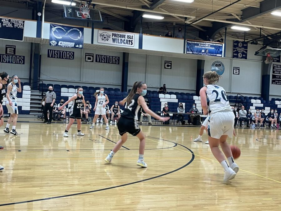 Sophomore+Anna+Jandreau+looks+for+options+on+offense+during+a+January+2021+game+against+Houlton.