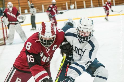 Sophomore Dawson Kinney battles with a member of the Bangor Rams during a January 2021 contest at The Forum in Presque Isle, Maine.