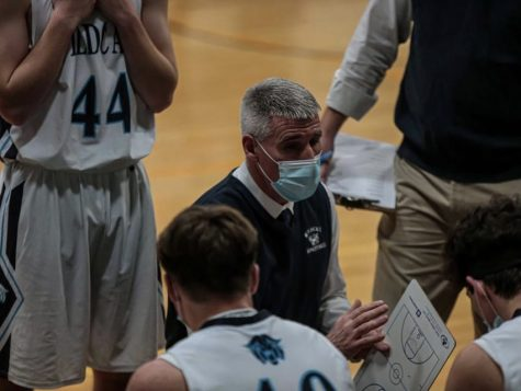 Head coach Terry Cummings talks with his team during a timeout amid a January 2021 game against Houlton.