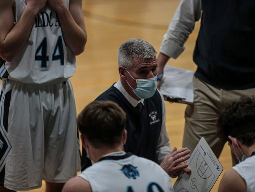 Head+coach+Terry+Cummings+talks+with+his+team+during+a+timeout+amid+a+January+2021+game+against+Houlton.