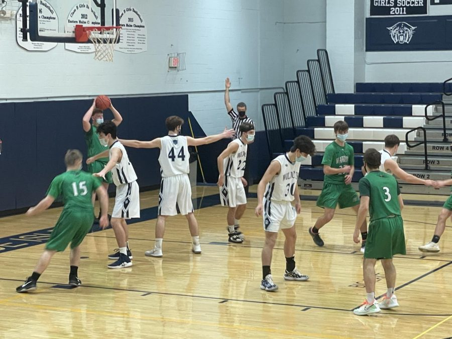 The Wildcats guard an inbound pass during Friday's contest with Fort Kent.