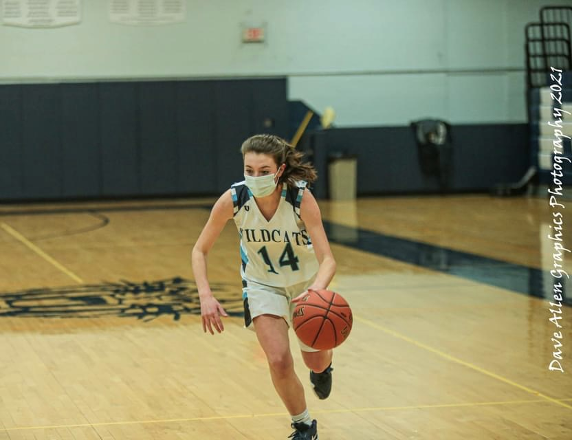Jenna Sargent (14) dribbles the ball in a game against Caribou earlier this month.