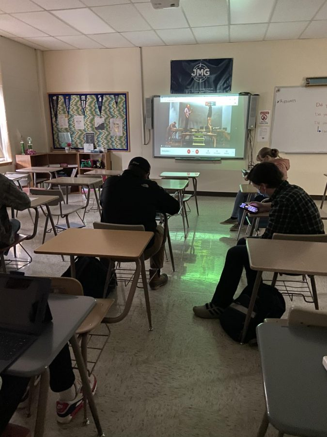 Students watch Class Feud remotely from Period 1.