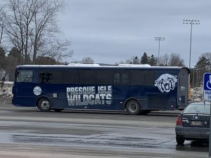 The newly wrapped bus, adorned in Wildcat logos, sits parked in Houlton.
