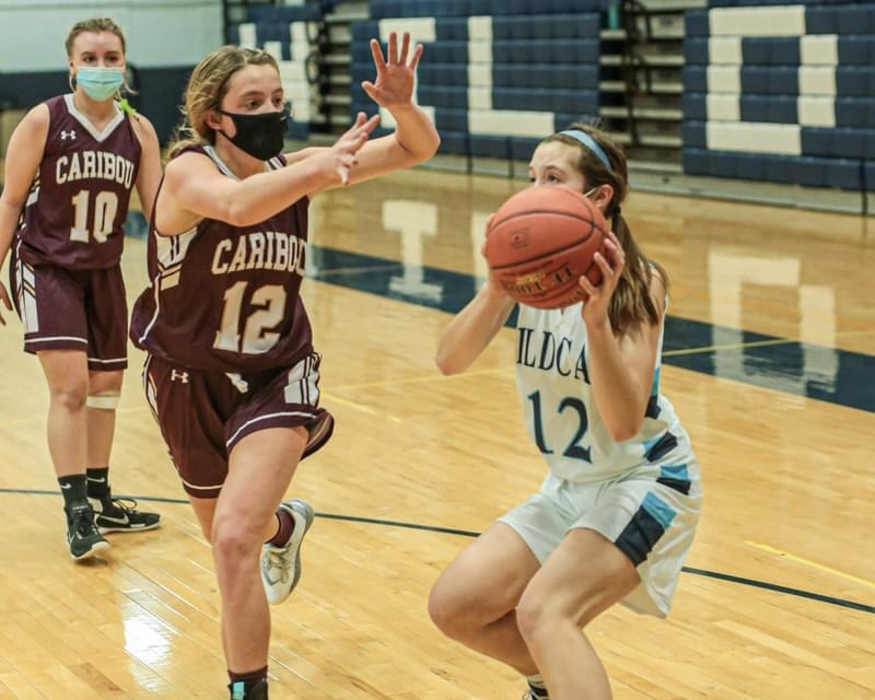 Junior Faith Sjoberg gets her defender moving with a hesitation on the baseline during a February 2021 matchup between Presque Isle and Caribou at PIHS.
