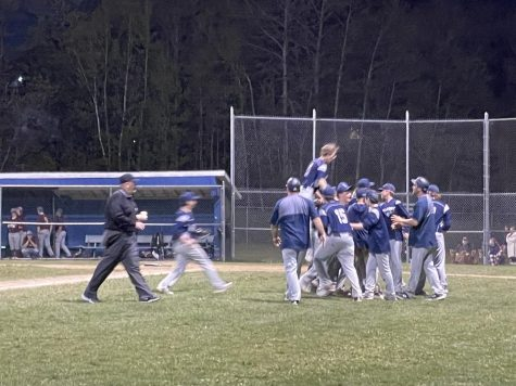 The Wildcats celebrate after a winning performance.