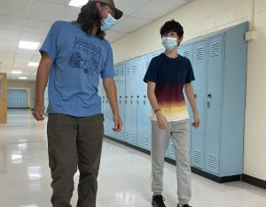Chase Guerrette 22 and Reagan Salcedo 25 walk the halls on September 3, a few days after the return of the mask mandate. I think everyones in the same boat that we would prefer not to wear them, said Libby Kinney 22. But we are doing whats needed.